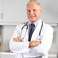 Portrait Of Doctor In Doctor's Office